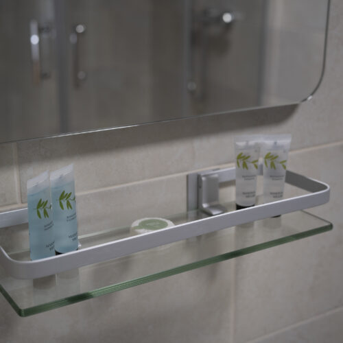 bathroom shelf with selection of toileteries