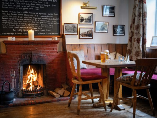 cosy bar room with roaring log fire